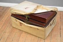 A CIRCA 1900's CHINESE LEATHER IMMIGRATION TRUNK WITH ORIGINAL COVER