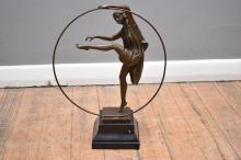A CLASSICAL BRONZE HOOP LADY IN THE STYLE OF GODARD ON MARBLE BASE