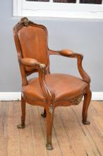 AN FRENCH EMPIRE STYLE LEATHER UPHOLSTERED DESK CHAIR