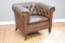 A CHESTERFIELD TUB CHAIR IN DISTRESSED LEATHER