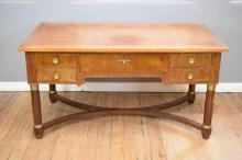 AN EMPIRE STYLE DESK WITH BRASS DETAILS AND MATCHING ARMCHAIR