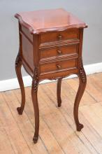 A LOUIS XV STYLE MAHOGANY THREE DRAWER BEDSIDE CABINET