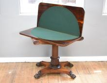 A LATE VICTORIAN ROSEWOOD FELT INSET GAMES TABLE