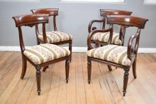 A SET OF EIGHT FINE WILLIAM IV MAHOGANY SPADE BACK CHAIRS WHICH INCLUDES TWO CARVERS