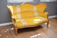A LOUIS XV STYLE SHAPED THREE SEAT SETTEE