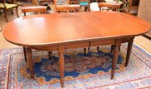 A 19TH CENTURY REGENCY STYLE MAHOGANY GATELEG DINING TABLE - missing castor and winder with staff.