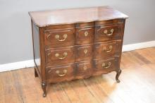 A LOUIS XV STYLE SHAPED COMMODE - missing corner of drawer in office.