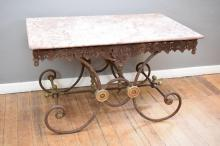 A 19TH CENTURY FRENCH STONE TOP BUTCHERS TABLE ON AN ORNATE IRON BASE
