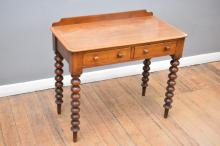 A VICTORIAN CEDAR TWIN DRAWER CONSOLE WITH REEDED LEGS