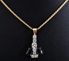 A SAPPHIRE AND DIAMOND PENDANT IN 18CT GOLD