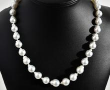 A STRAND OF BAROQUE SOUTH SEA PEARLS TO A 9CT GOLD CLASP