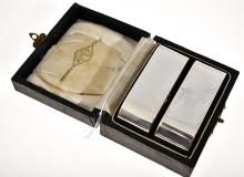 A PAIR OF APEX NAPKIN HOLDERS SET IN STERLING SILVER, BOXED