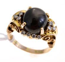 A CABOCHON BLACK SAPPHIRE RING