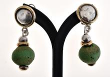 A PAIR OF STERLING SILVER EARRINGS WITH GREEN STONE DETAIL