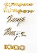 A COLLECTION OF CAR BADGES, INCL. 'BONGO', 'WAGON' ETC