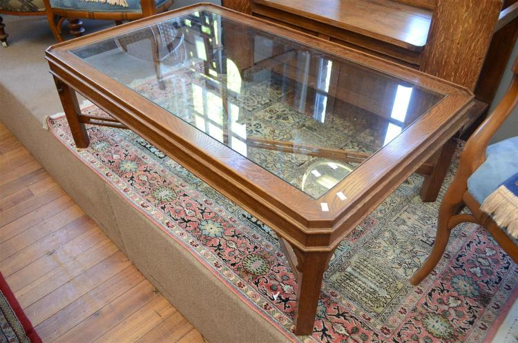 A PROVINCIAL STYLE GLASS TOP COFFEE TABLE h42 x w123 x d75cm