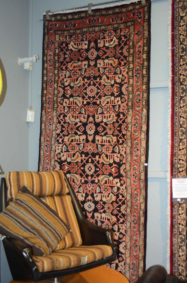 A PERSIAN MALYER HALL RUNNER, 100% WOOL PILE HAND KNOTTED IN IRAN, WITH RICH NAVY GROUND TONES AND HERATI MAHI MOTIF, 320 X 112 CM,...