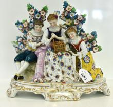 A SAMPSON PASTE PORCELAIN FIGURAL GROUP OF THREE CATCHING BIRDS