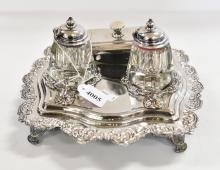A SILVERPLATED DOUBLE INKWELL SET