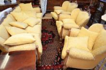 A LOUIS XVI STYLE DAMASK UPHOLSTERED LOUNGE SUITE, COMPRISING ONE FOUR SEATER SOFA AND THREE ARMCHAIRS