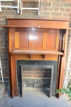 A BLACKWOOD ARTS AND CRAFTS FIRE SURROUND/OVERMANTLE