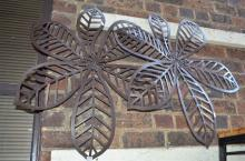 TWO WROUGHT METAL DECORATIVE WALL HANGINGS WITH FLORAL MOTIF