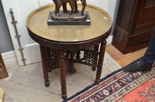 AN ANTIQUE INDIAN OCCASIONAL TABLE WITH DECORATIVE BRASS TRAY