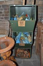 A VINTAGE INDUSTRIAL SET OF THREE SHOE STORAGE CONTAINERS INCLUDING MOULDS