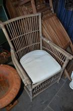A PROVINCIAL CANE AND BAMBOO OUTDOOR ARMCHAIR