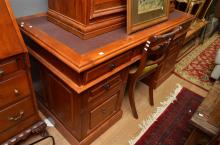 A PINE DESK WITH INSET TOP