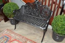 A BLACK CAST IRON BENCH SEAT