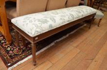 AN UPHOLSTERED HALLWAY BENCH
