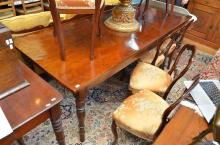 A LARGE PROVINCIAL OAK DINING TABLE