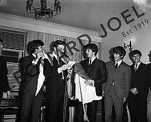 THE BEATLES RECEIVING ANIMAL SKINS AT CONFERENCE/RECEPTION