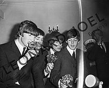 THE BEATLES SMELLING BOUQUETS AT CONFERENCE/RECEPTION