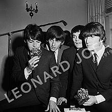 THE BEATLES HOLDING BOUQUETS (PAUL MCCARTNEY SMELLING BOUQUET)