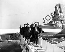 THE BEATLES WAVING WHILST DISEMBARKING AT ADELAIDE AIRPORT