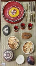 A COLLECTION OF ITEMS INCLUDING SHELLS, PAINTED STONES, ETC