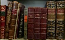 A SHELF OF ANTIQUE BOOKS