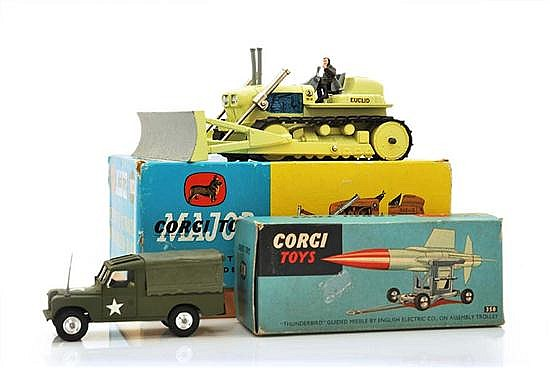 THREE CORGI MILITARY MODELS INCLUDING 357 LAND ROVER WEAPONS CARRIER WITH LEMON YELLOW INTERIOR; 1102 'EUCLID' TC-12 TRACTOR WITH DO.