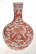 CHINESE IRON RED DECORATED BOTTLE VASE WITH REPEATING DRAGON SCENE, FOUR CHARACTER MARK TO BASE,