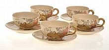 SET OF FOUR JAPANESE SATSUMA TEA CUPS AND SAUCERS WITH GILDED BIRD SCENE