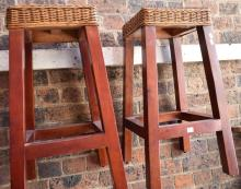 A PAIR OF CANE AND TIMBER STOOLS