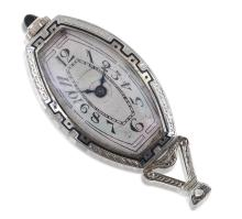 AN ART DECO PENDANT WATCH, MANUAL WIND MOVEMENT, TONNEAU CREAM DIAL WITH BLACK ARABIC NUMERALS, PLATINUM CASE WITH DIAMOND AND ENAME...