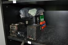 A PART SHELF OF CAMERA AND LIGHTING EQUIPMENT INCLUDING BROWNIE