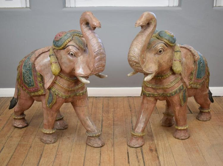 A PAIR OF LARGE FIGURAL CARVED ELEPHANTS (100cm h x 100cm l)