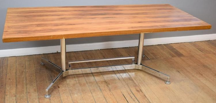 A VINTAGE TIMBER TOP TABLE ON CHROME BASE