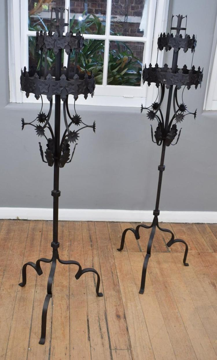 A PAIR OF MEDIEVAL IRON CANDLESTICK HOLDERS (150cm h)