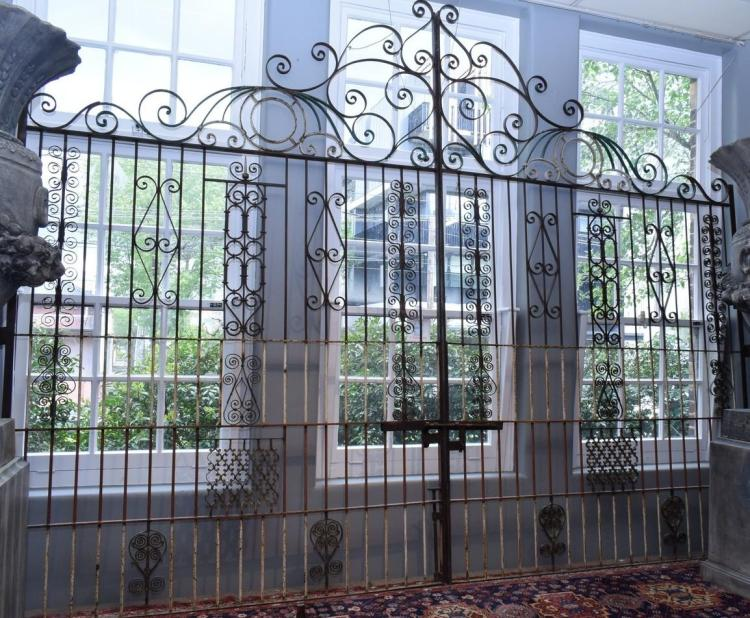 A PAIR OF IMPRESSIVE SPANISH PROVINCIAL WROUGHT IRON GATES (2m w x 3.2 h)