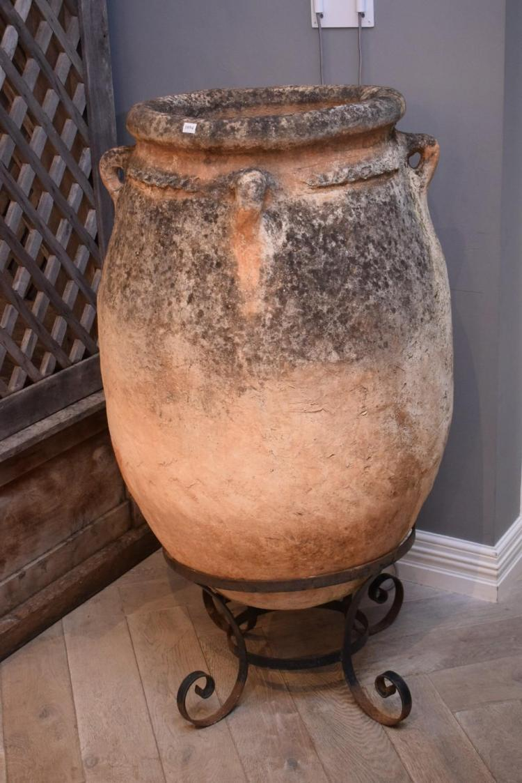 A SPANISH TERRACOTTA URN ON IRON STAND (70cm w x 1.25m h)